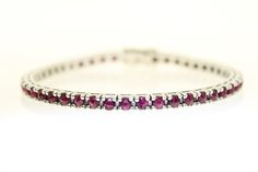Blood Red Ruby Sapphires set in White Gold, a  bracelet you will never wish to take off. Exclusively available www.Aminluxury.com