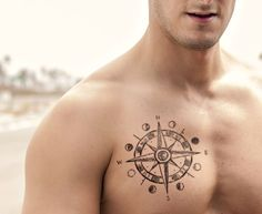 Compass tattoo with moon phases on chest rib tattoos for guys, star tattoos f Compass Tattoo Meaning, Compass Tattoo Design, Feminine Compass Tattoo, Rib Tattoos For Guys, Trendy Tattoos, Star Tattoos For Men, Body Art Tattoos, New Tattoos, Cool Tattoos