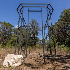 """Memorial, Olivia Martin Moore, Convict Hill Quarry Park (temporary installation), 2015 """"Memorial"""" is a temporary public art  installation commissioned by the Austin Art in Public Places TEMPO project. An architectural folly of a typical jail cell,  the sculpture memorializes the eight convicts who died while quarrying the site to supply limestone rock for the State Capitol building.  TEMPO is a project of the City of Austin Economic Development Department/Cultural Arts Division."""