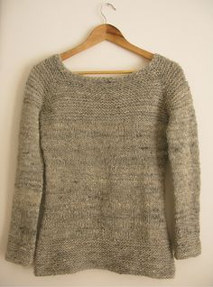 A simple sweater with chunky garter stitch accents to show off your handspun yarn. The yarn shown is handspun from handcarded batts available from my Etsy shop Caora Fibres. The sweater is worked in the round from the top down with raglan sleeves.