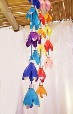 Plastic Tulips made from Plastic Water Bottles or Soda Bottles. String together and hang as a decoration or add lights in the center of the flowers.