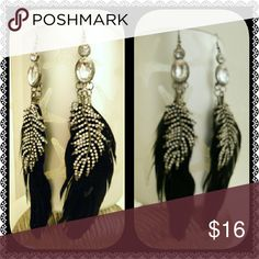 Long Metal Gem & Feather Earrings Long earrings.  Black feather with metal feather accent & clear diamond like gems . Beautiful pieces!  See photo: dried glue on feather.  BUY 2 PIECES OF JEWELRY & GET 1 PIECE FREE!!  Comment/tag your items for a listing. Jewelry Earrings