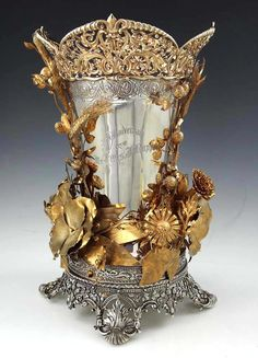 A Rare and Important Gorham Antique Sterling Silver and Gilded Vase. 1889.