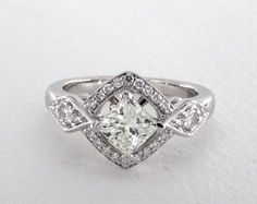 14K White Gold Vintage Setting | A breathtaking Art Deco geometric halo with geometric pave side pave shank is the perfect compliment to the princess cut diamond or gemstone of your choice. | Ring Style 17022W14