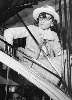 Seated on a staircase, French designer Coco Chanel watches her Spring-Summer 1969 collection being presented Jan. 28.