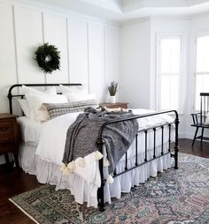 White farmhouse bedroom with board and batten wainscot on the walls White Iron Beds, White Metal Bed, Black Metal Bed Frame, Bedroom Bed, Guest Bedrooms, Home Decor Bedroom, Bedroom Headboards, Bedroom Green, Bed Room