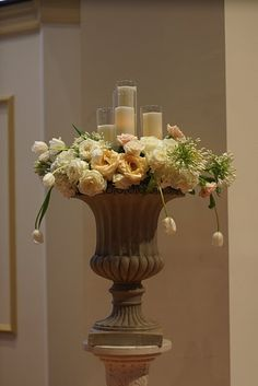 a combination of flowers and candles - perfect for an altar or focal point at the reception. with white renoncules roses even better! Altar Flowers, Church Flowers, Table Flowers, White Wedding Flowers, White Flowers, Floral Wedding, Gold Wedding, Wedding Ceremony Decorations, Wedding Centerpieces