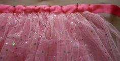I luv tutus but dont much care for the look of the knotted ones. Excited to find a good tutorial for a sewn tutu.