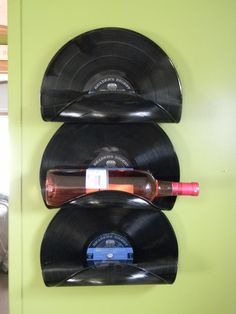 I want to make these too! DIY wine rack. Making album art is awesome. Bake at 200F for 10 minutes, take out and shape right away....it would have to be really terrible music to ruin a record but cute idea