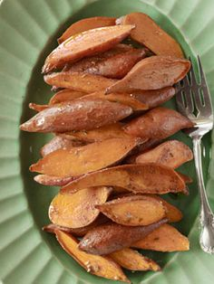 Here roasted sweet potatoes are slathered with a spiced and sugared butter.