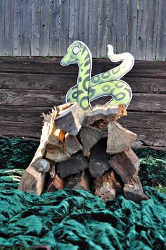 "I drew and painted ""The snake' on a piece of foam board, cut it out with a knife and stuck it on a pole, which I then stuck into a 'his log pile house'. Every child had their photo taken with the snake at the party."