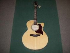 Takamine EG523SC Acoustic Electric Guitar Brand New In The Box with tags almost half price! only $495.