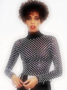 Whitney Houston wearing Marc Bouwer beaded catsuit