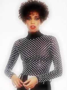 Whitney Houston wearing Marc Bouwer beaded catsuit