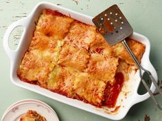 Enchilada Lasagna Roll-Ups Recipe from Food Network - tasty idea for a Mexican flavored Pasta Dish Mexican Dishes, Mexican Food Recipes, New Recipes, Cooking Recipes, Favorite Recipes, Recipies, Enchilada Lasagna, Enchilada Rice, Easy Rolls