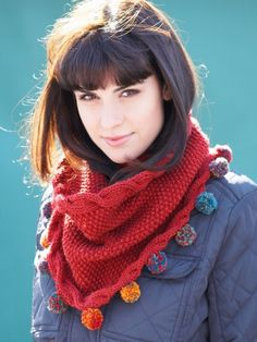 Free Pattern - A gorgeous seed stitch cowl edged with sideways cables becomes more funky with pompoms made in a coordinating shade Bernat Mosaic. #Knit in Bernat Super Value.