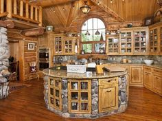 Awesome log cabin kitchen with round island.