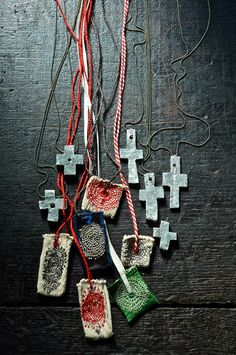 pewter cross necklace with embroidered tiny sac by JunkoOKi. ¥28,800, via Etsy.