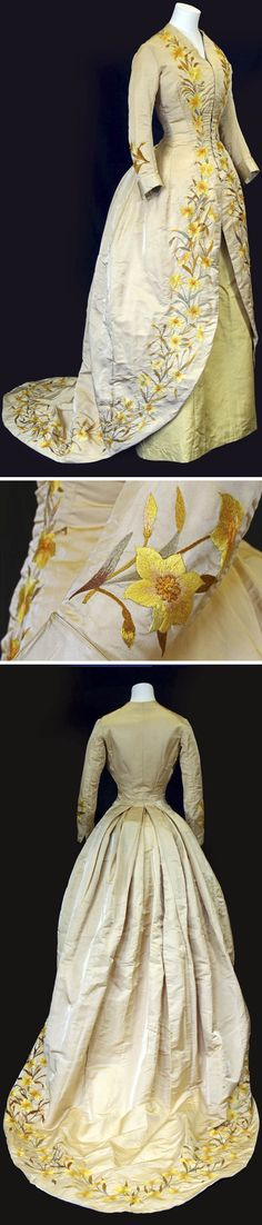 Tea gown, Philadelphia, circa 1892. Beige silk lined with yellow silk satin; yellow underskirt. Hand-embroidered with daffodils. Small glass beads form the center of the flowers. Front opening with hook & eye fasteners. Via American Museum in Britain.