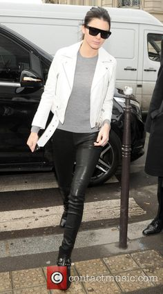 Kendall Jenner out in Paris wearing black leather pants, grey sweater and a white jacket