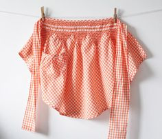 Smocked gingham aprons were the rage in the 1950's.  Women made up their own designs and patterns to express their personal style and creativity.