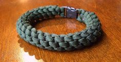 """Here's a crown sinnet(round) paracord bracelet with a side release buckle(3/8""""). The paracord's inner strands were left intact."""