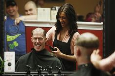 Michael Couch gets his head shaved as part of the Pink in the Rink fundraiser