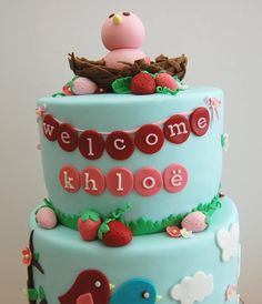 Berry Bird Baby Shower Cake - 2 tiered baby shower cake for my friend Katie. I had creative full creative freedom to do whatever i wanted with this cake and I picked to combine things that she loved or was connected with her baby. Katie's shower invites had cherry blossoms in it, she's loved strawberries ever since Ive known her and to bring in the baby factor (and with a little help from my friend) i added cute little baby bird. I made Vanilla Cupcakes and decorated to match the theme as…