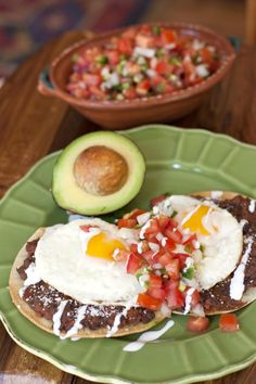 A classic Mexican breakfast, huevos rancheros are fried eggs served on lightly crisp corn tortillas smothered in beans or salsa. #huevosrancheros #rancheros #refriedblackbeans #latinrecipes #mexican #mexicanrecipe #muybueno | muybuenocookbook.com @muybueno