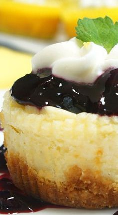 Lemon Cheesecake Cupcakes with Blueberry Sauce