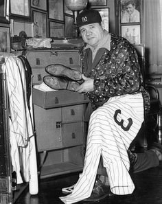 New York Yankees Babe Ruth puts away cleats.  (Sporting News Archives)