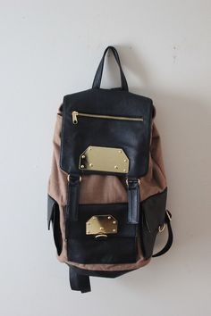 I really want a nice leather backpack for school, and because I insist on bringing everything I own with me everywhere I go.