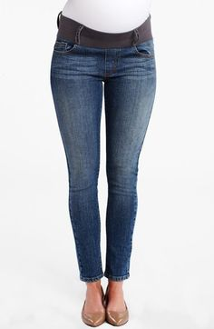 Maternal America Maternity Ankle Skinny Jeans. Allover fading and whiskering gives an old-school look to skinny-leg jeans topped with a wide elastic band to accommodate and support your changing silhouette.