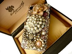 custom iphone case done for a client right before Christmas 2011. Isn't is gorgeous? Swarovski crystals, pearls, jewels...pure iphone bliss