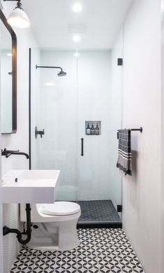 Tiny Bathrooms 358669557824717574 - Bold graphic flooring adds a subtle pop to the streamlined black and white bath. Photo 1 of 35 in Stewart-Schafer Brooklyn Brownstone Renovation by Anna Squier Source by LouWhoBryant Tiny Bathrooms, Tiny House Bathroom, Bathroom Design Small, Bathroom Layout, Bathroom Interior Design, Bathroom Ideas, Bathroom Designs, Small Bathroom Floor Plans, Boho Bathroom