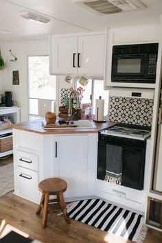 Discover that less really is more when you tour the beautiful revamped RV that Ashley Petrone shares with her family of five.