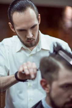 Barber Cutting Hair to a Client by Milles Studio for Stocksy United
