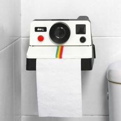 The POLAROLL Toilet Paper Holder from DOIY Design is an LOL inducing cheeky (no pun intended) innovation. Your usual TP holder on hinges is covered up with what looks like a retro Polaroid camera. It's not just for show either, because it dispenses instant toilet paper from the slot where the camera spits out the photograph. It looks authentic and the roll is discreetly hidden behind the camera, so there's no way to tell that this is not a camera taking voyeuristic pictures of you doing the…