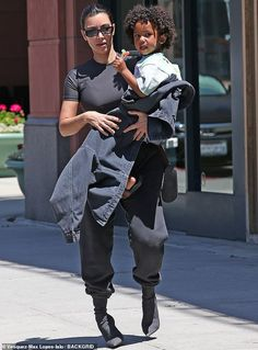 Kim Kardashian carries son Saint while out in LA - Mommy and me: Kim Kardashian, was seen out in LA on Sunday with son Saint West, three Source by pokornayal - Fashion 2020, New Fashion, Fashion Outfits, Kardashian Style, Kardashian Jenner, Jenner Kids, Jenner Family, Baggy Sweatpants, Kim K Style