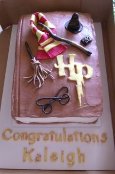 Harry Potter themed baby shower cake. Fondant decorations/wording. Chocolate buttercream icing (vanilla buttercream) for pages.