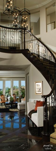 Marble and wood duo floors with curved staircase