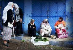 Shop Girl Blues - A photo from the blue walled city of Chefchaouen, Morocco.