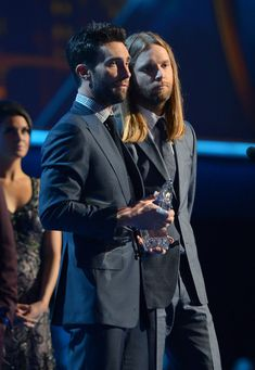 Adam Levine Photos Photos - Musicians Adam Levine (L) and James Valentine of Maroon 5, winner of Favorite Band, accept their award onstage at the 39th Annual People's Choice Awards at Nokia Theatre L.A. Live on January 9, 2013 in Los Angeles, California. - 39th Annual People's Choice Awards - Show