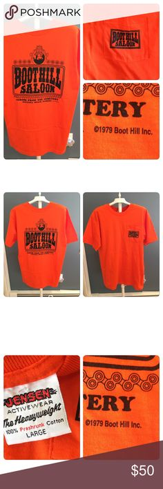 Vtg 1979 Boothill Saloon Tshirt Vtg 1979 Boothill Saloon Tshirt. Printed on a bright orange Jensen brand 100% cotton pocket tee. Double sided graphics. No holes stains rips tears. No fading or cackling of graphics. Vintage Shirts Tees - Short Sleeve