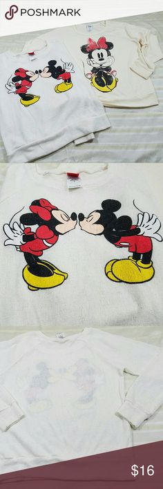 DISNEY BRAND MINNIE & MICKEY MOUSE SWEATERS Two Disney Brand Mickey and Minnie sweaters. Size small. Both sweaters are slightly shear and are made of polyester,  rayon, and spandex. Mickey and minnie kissing printed on a white knitted sweater has some glitters in the paint. Just Minnie mouse sweater, is a cream color and has a small mark on sleeve, shown in picture.  No holes. Super cute sweaters perfect for  Disney Park Vacation! Disney Sweaters Crew & Scoop Necks