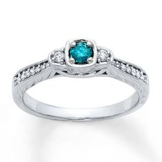 This ring. yall. Its BLUE and has tiny diamonds around it. This RING. I want it. (i dontcare that Kay calls it an engagement ring)  Diamond Engagement Ring 1/4 ct tw Blue/White 10K White Gold