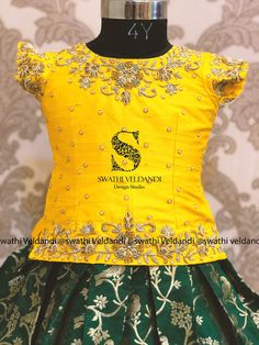 Stunning yellow color traditional kids parikini and green color lehenga. call/watsapp for details 06 October 2019 Kids Dress Wear, Kids Gown, Dresses Kids Girl, Kids Outfits, Kids Indian Wear, Kids Ethnic Wear, Kids Blouse Designs, Simple Blouse Designs, Kids Frocks Design