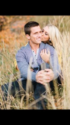 Engagement picture with the girl kissing the guy... I like it a lot (
