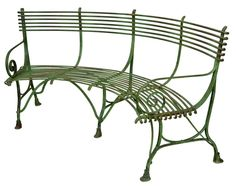 French Green Iron Curved Garden Bench with scroll arms and hooved feet; originally designed for the Luxemborg Gardens; 20th Century.