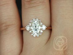 This engagement ring is designed for those who love simple with a slight twist. With the combination of both the 3 stone and halo together, the ring is truly unique!  All stones used are only premium cut, fairly traded, and/or conflict-free! Our diamonds are always natural NEVER treated or enhanced for better color or clarity. Our products are only created with the finest of recycled metals. Rosados Box™ works hard to save the world one piece of jewelry at a time! :)  To see the matching